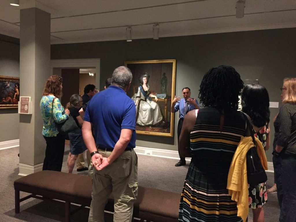 People listening to a speaker in the Ackland Art Museum.