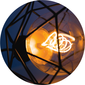 Decorative image of old light bulb and geometric metal framework.
