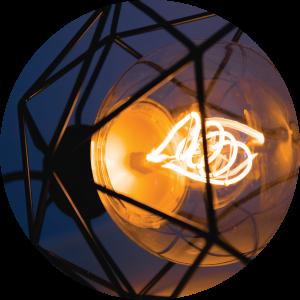 Decorative image of old light bulb and geometric metal framework.